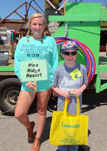 Resort Race Winner: Haydon Carr, left, age 7, representing Pine Ridge Resort, and Sammy Fuqua, helper with the resort race.