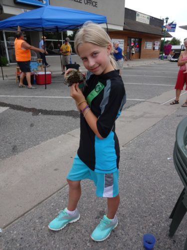 Lizzie Stone raced her pet box turtle and won a green ribbon